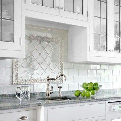 Subway Tile Backsplash With Pretty Insert Over Sink Backsplash