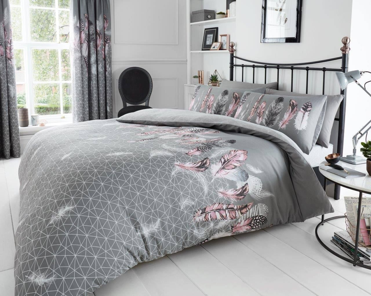 Features a delicate feather and geometric design.  #Reversible design #featherduvetset #bedset #bedroomcomforts #cosybedrooms #featherbedset #theaccessoryzone