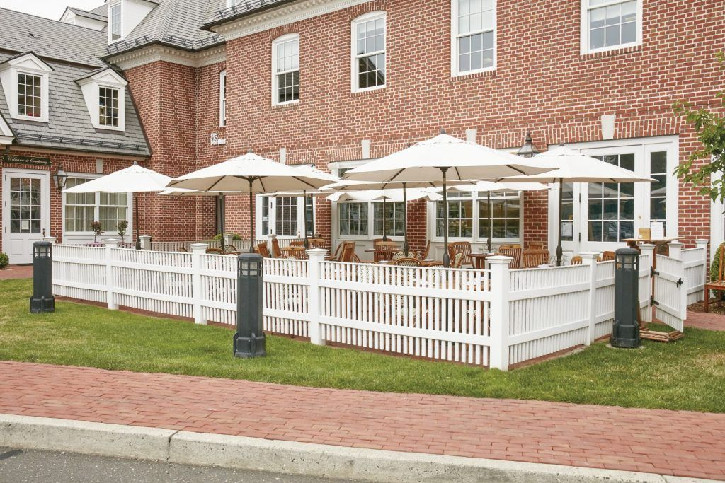 A Perimeter Fence Fabricated In Long Lasting AZEK Encloses This Outdoor  Patio In Connecticut.