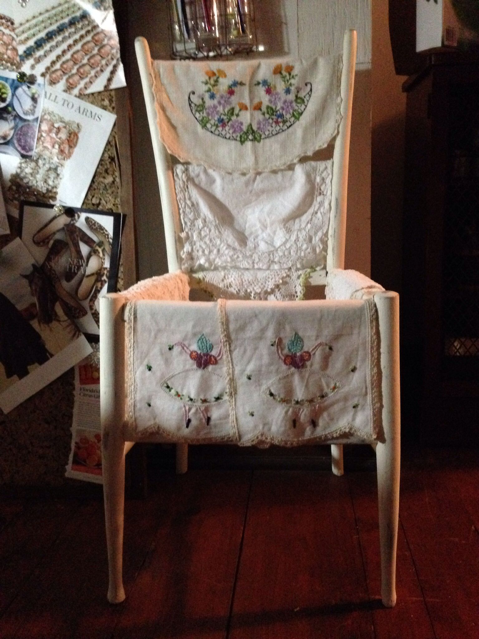 My friend's childhood chair makes a great display for my vintage linen