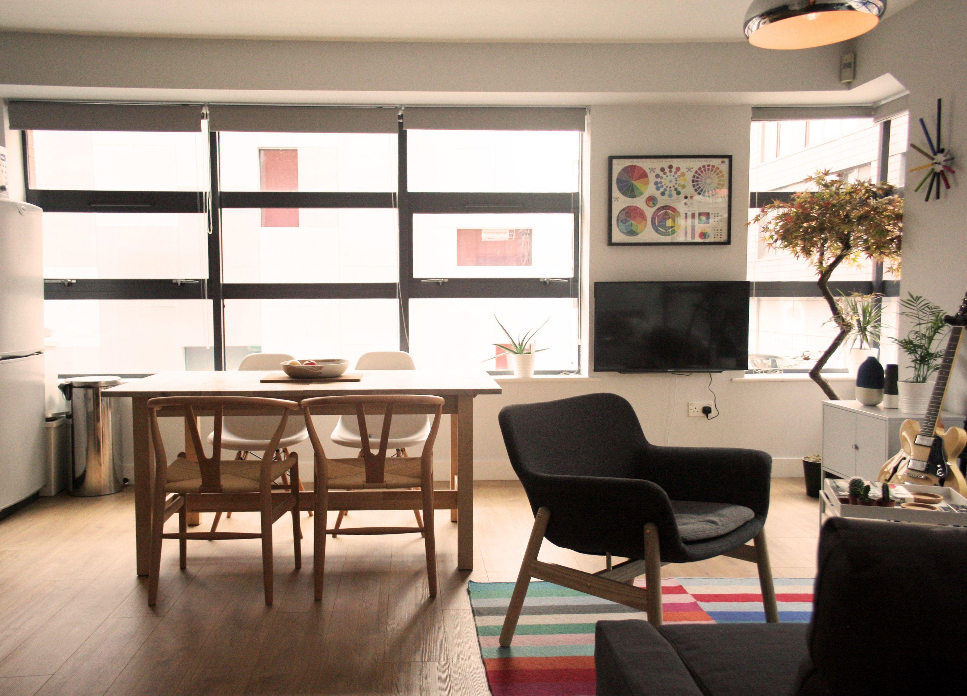 Hans Wegner Wishbone chairs IKEA Vedbo armchair Habitat lamp