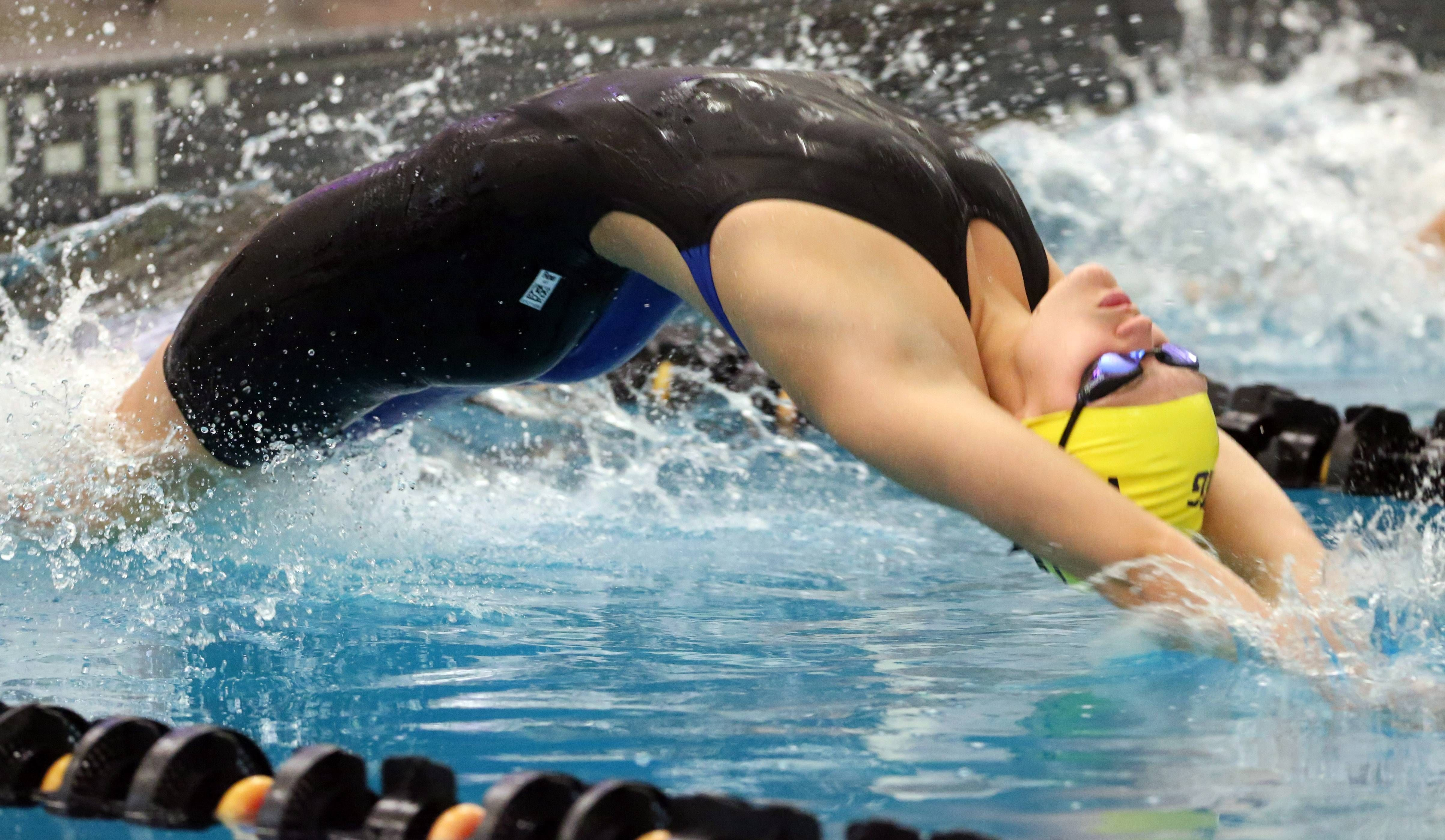 Wheeling's Theresa Godlewski starts her pool-record 100-yard backstroke (56.93) effort during the Mid-Suburban League girls swimming meet on Saturday at Barrington.