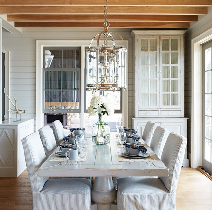 cottage style dining room with stripe slipcover chairs and lantern lighting muskoka living dining room decorating ideas pinterest cottage style