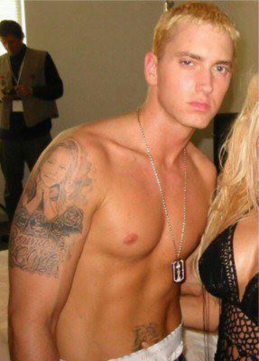 Eminem- he has more muscle here but looks a bit stoned :3 ...