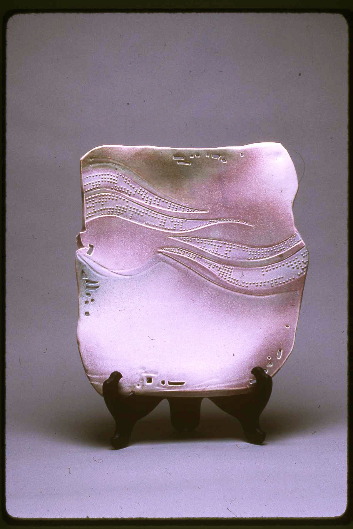 Christy Johnson - Slab wall piece; textured and slip trailed; egg-shell matt glaze over porcelain; airbrushed oxides; reduction fired.