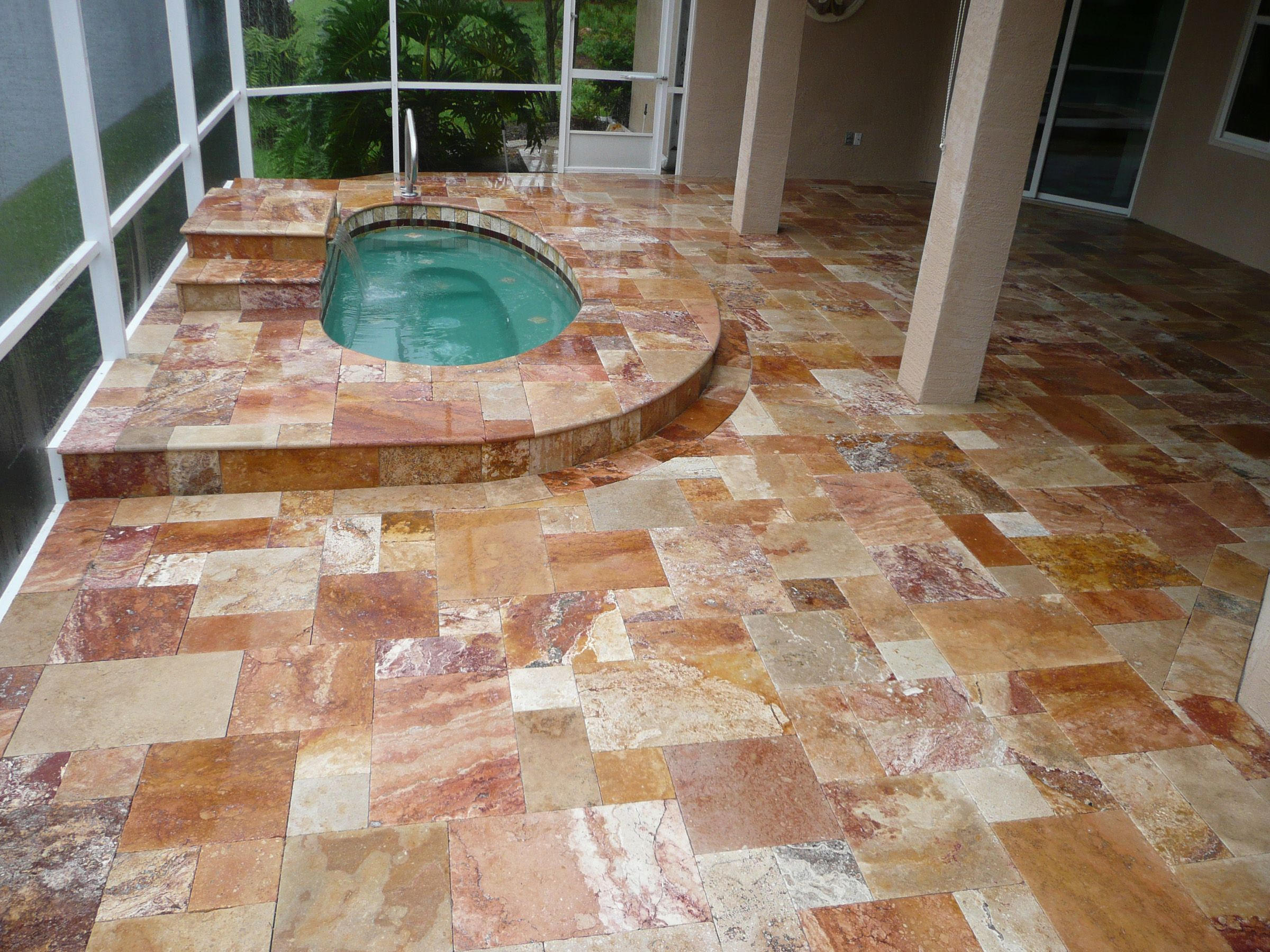 autumn blend travertine pavers in a french pattern design. www