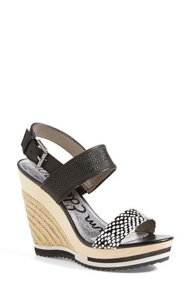 A cute pair of black and white wedge sandals by Sam Edelman
