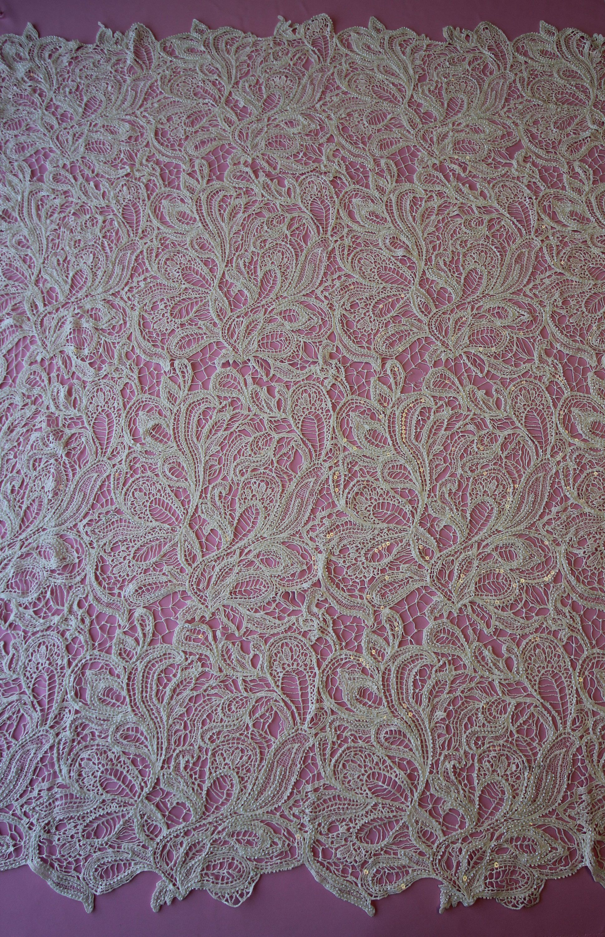 Enchanting and tantalising, Spirit has been created through Guipure Embroidery. With no backing, the fabric is an intricate blend of flowing shapes into on another. Resembling a paisley or marquise, beading follows the outline of the shapes creating a shimmer effect. Reminiscent of 1920s glamour, this fabric oozes charisma. This lace measures 52 wide. LISTING IS FOR 1 YARD! WE CAN GET AS MANY YARDS AS YOU NEED! We are the go to source for designers and dressmakers looking to add a unique…