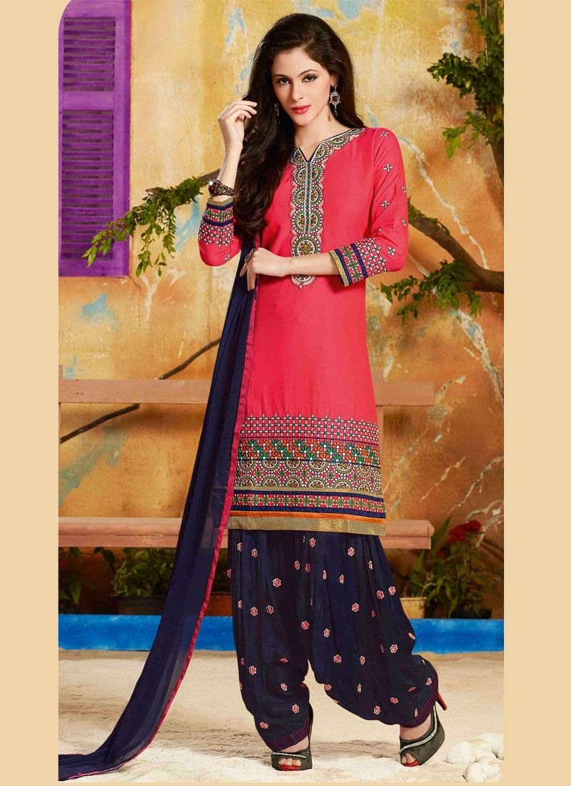 Hot pink cotton   designer salwar suit designed with embroidered and lace work. Comes with matching bottom and dupatta.(Slight variation in color, fabric & work is possible. Model images are only repr...