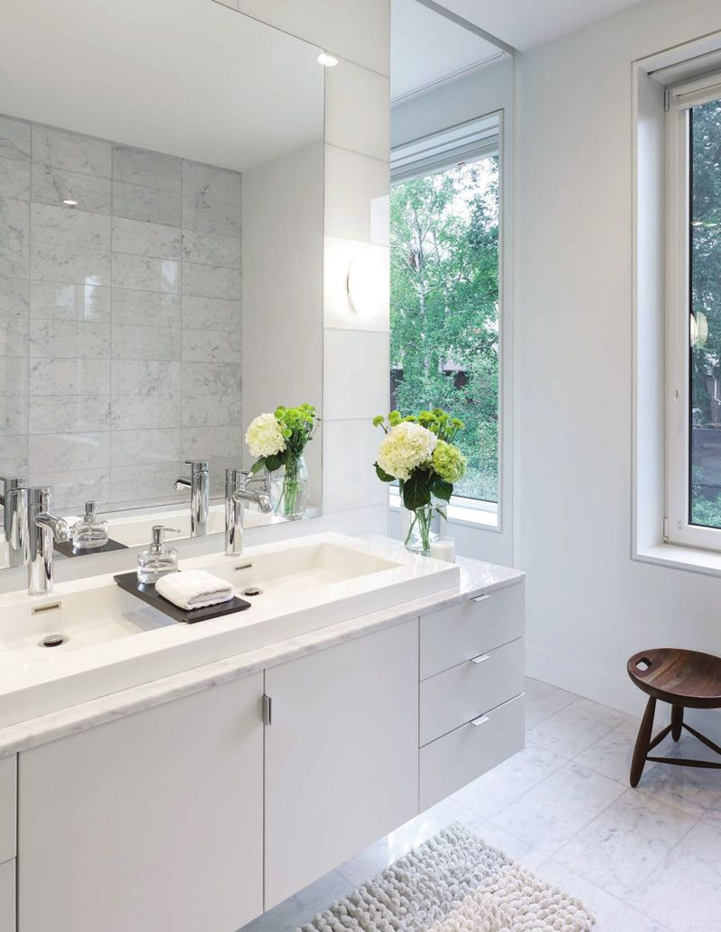 This bathroom features a floating vanity with a large double sink ...