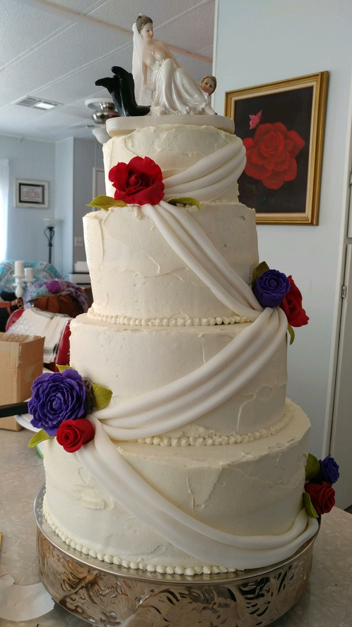 Red roses and purple peony wedding cake. Wedding cake