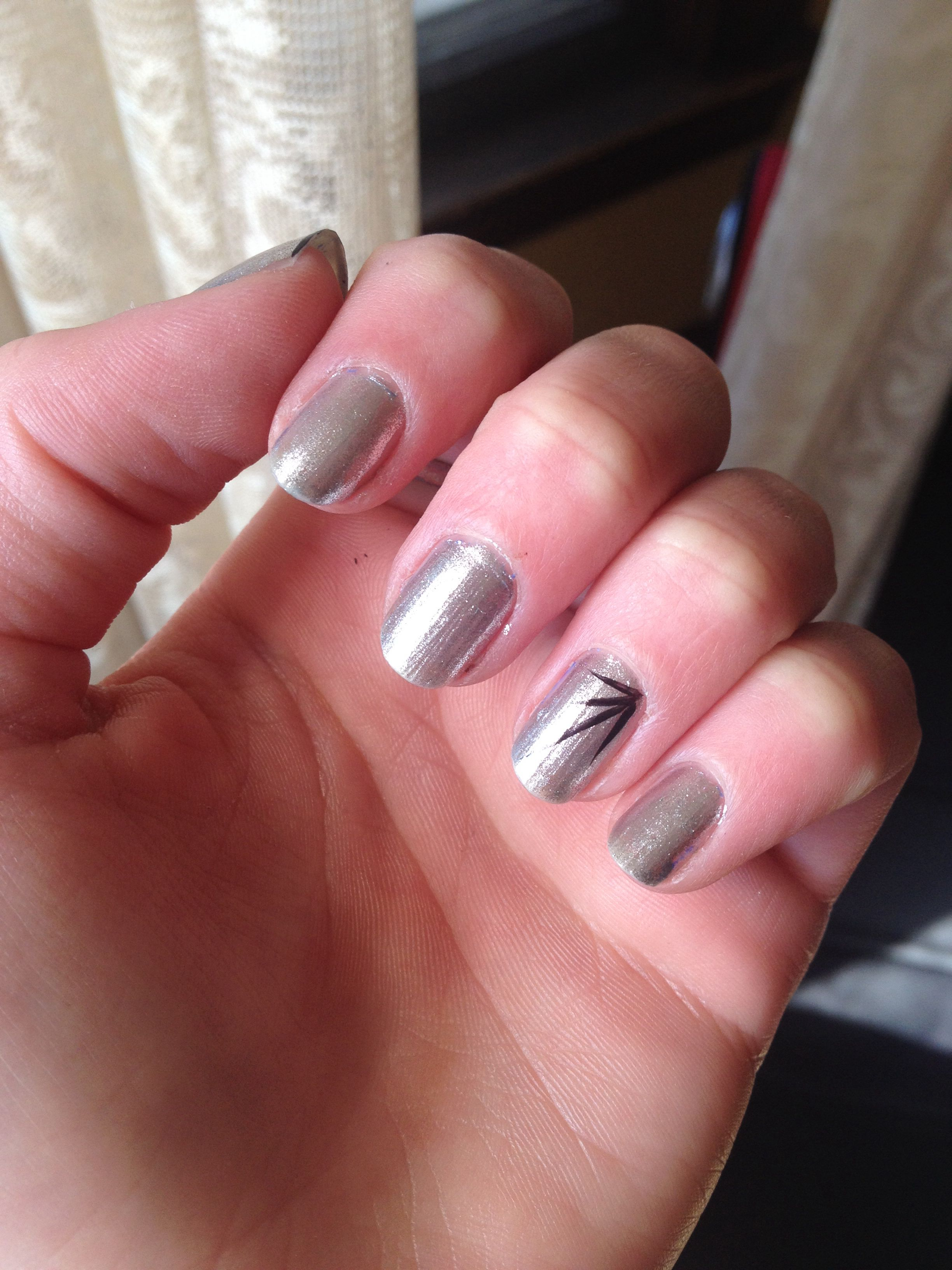 Silver Xtreme Nail polish, use a black thin tip for the easy line ...