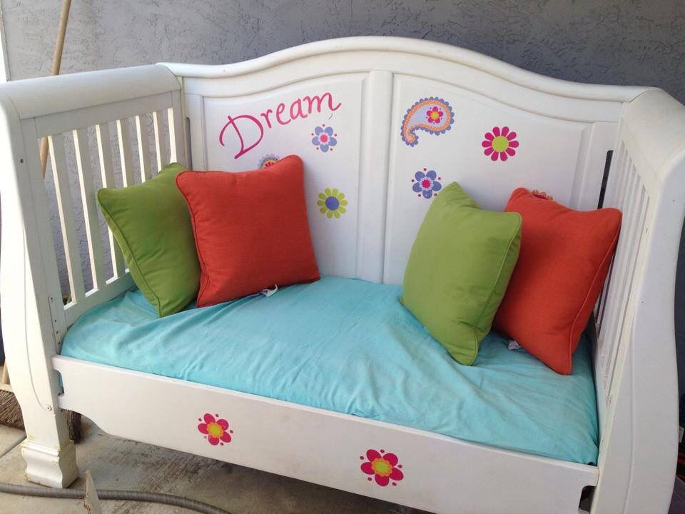 love this idea for an outgrown crib, cozy little reading corner