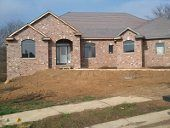 Colonial Brick Corp. (Smoketone Blend) we have picked out for the exterior of the house.  Using a large brick to minimize mortar lines.  House pictured is a local house in Sherman, IL using the same brick.