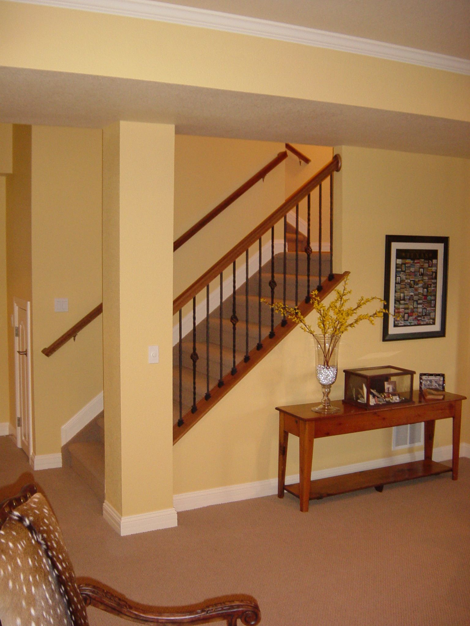 When homes are constructed with unfinished basements  the basement stairs not typically given aesthetic