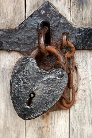Ancient heart shaped padlock on the door of Caenarfon Castle,..