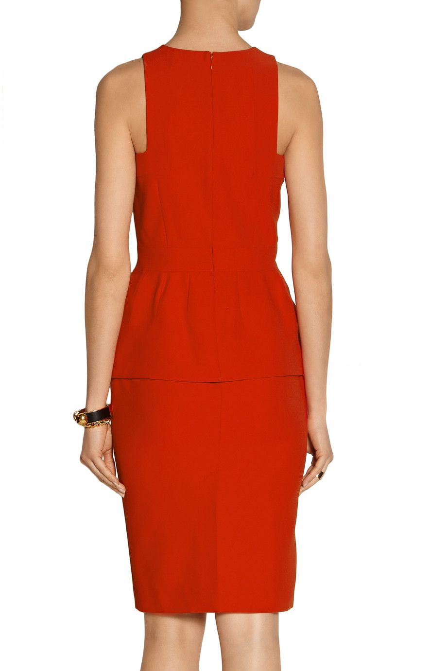 Red crepe Peplum, back vent, fully lined Concealed hook and zip fastening at back 50% acetate, 50% rayon; lining: 75% rayon, 25% silk Dry clean