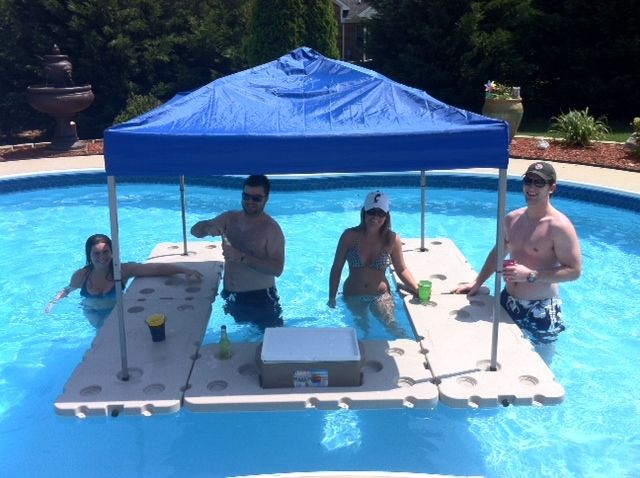 Floating pool bar pictures this will have to do until a for Above ground pool storage ideas