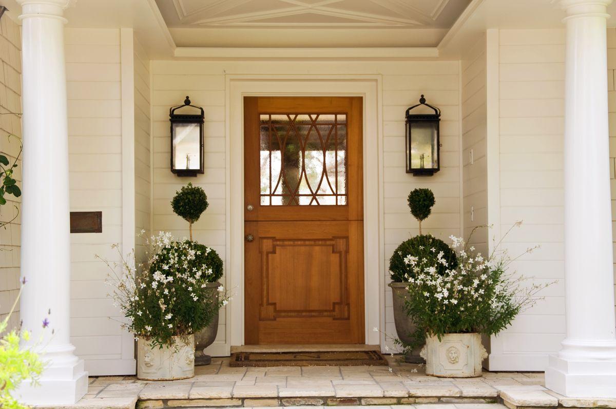 front door lighting tips with lanterns flanking a front door