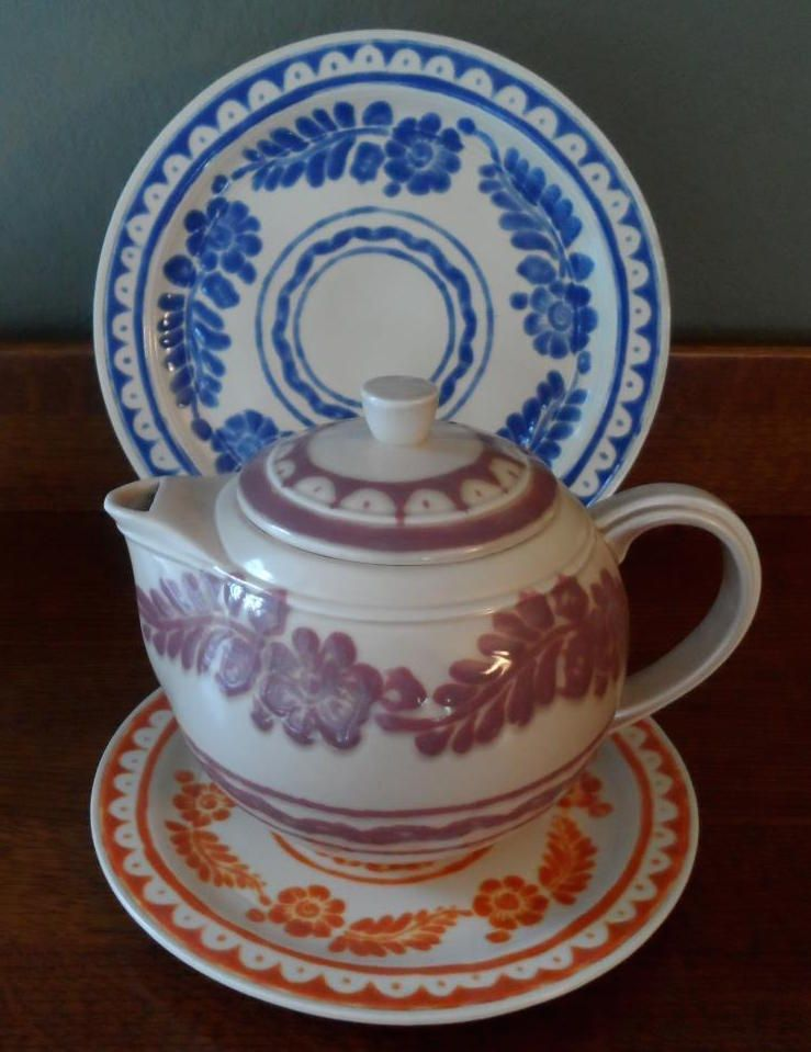 Two plates and the tea pot from the \ Olinala-Aztec\  dinnerware line by & Two plates and the tea pot from the \