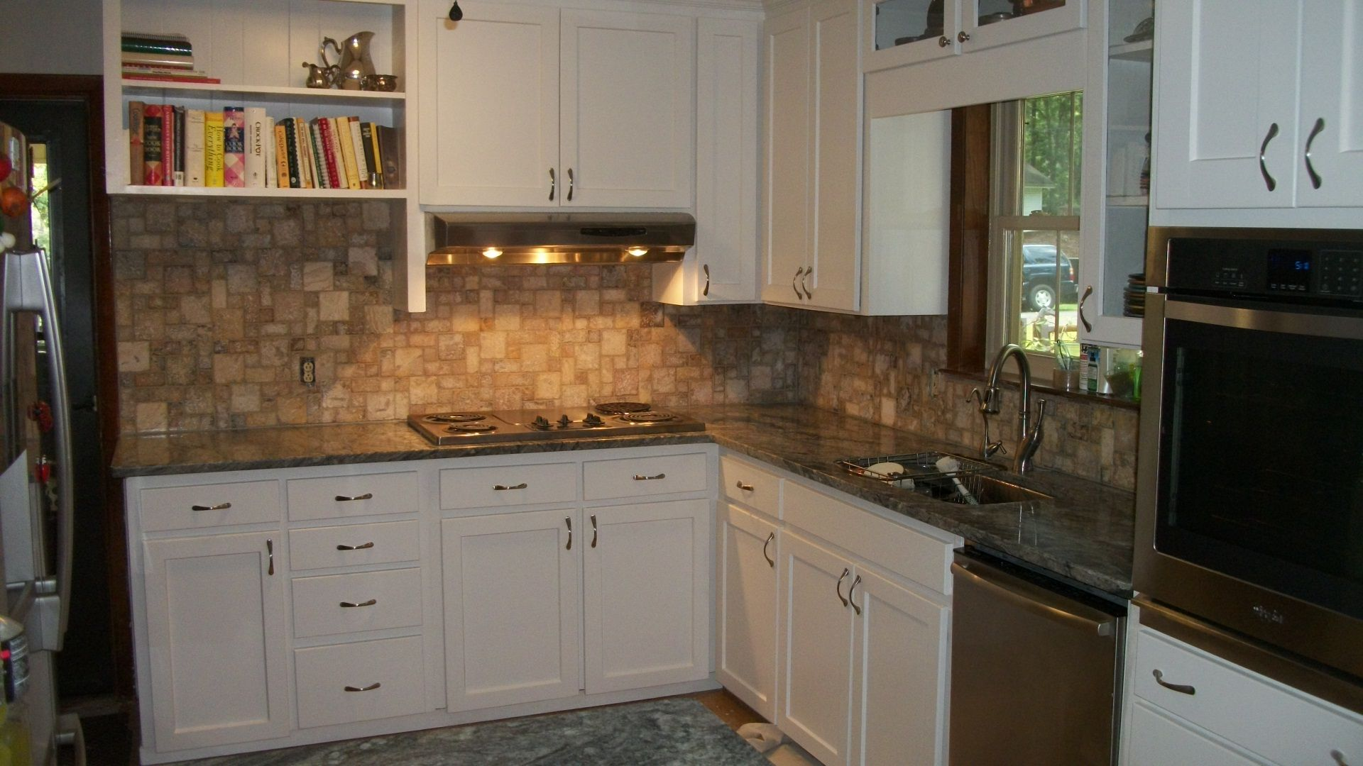 We made modified Shaker style cabinet doors & drawer fronts for this