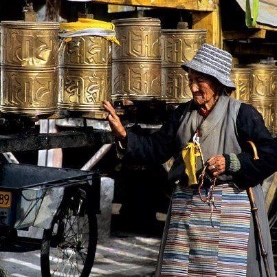 Tibetan woman praying,   Lhasa, Tibet