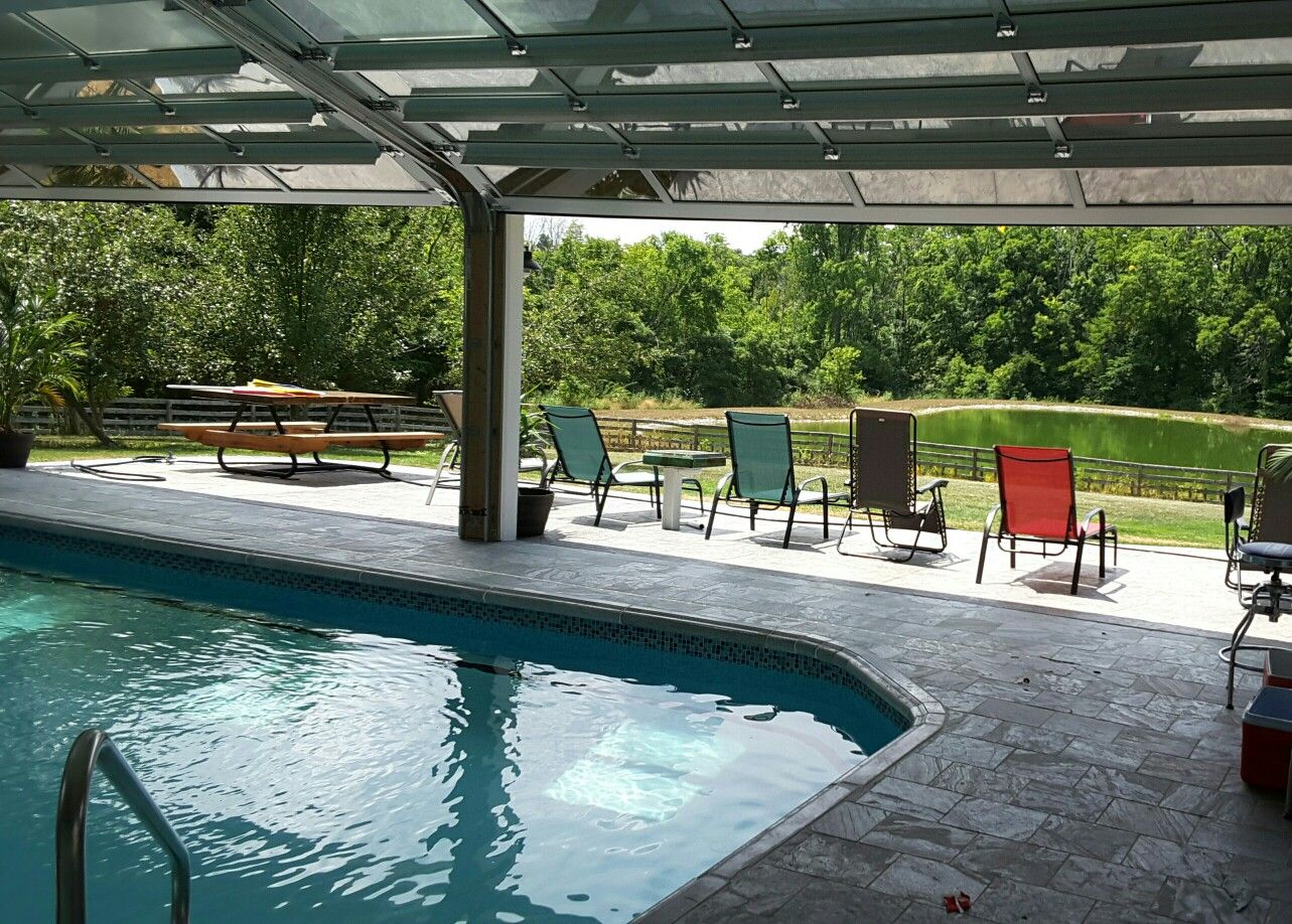 We Added Glass Garage Doors To The Back Wall Of This Indoor Pool Indoor Outdoor Pool Pool Houses Indoor Pool