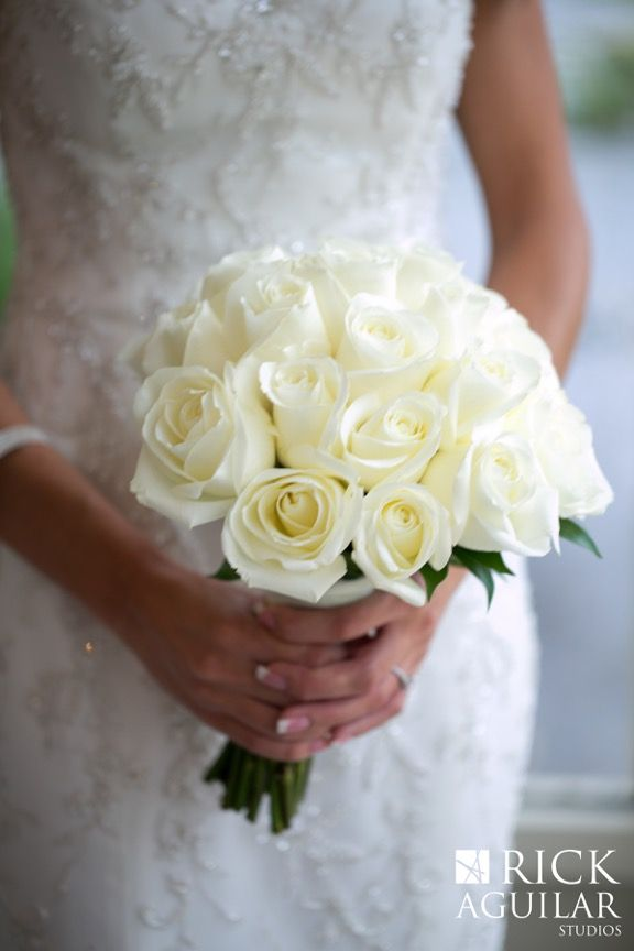 The gorgeous simplicity of a white rose bouquet is timelessly elegant.
