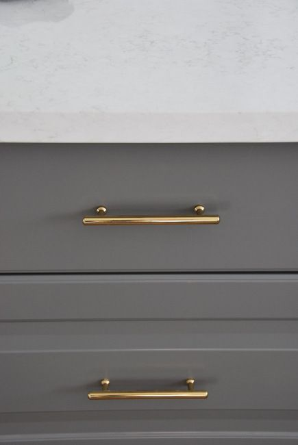Installing Gold Cabinetry Hardware In A Grey And White Kitchen Via The Sweetest Digs