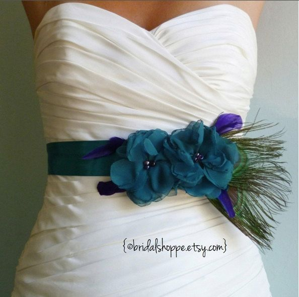 Wedding Sash Belt MALLORY - Two Teal Flowers on Teal Satin with Peacock Feathers via Etsy.