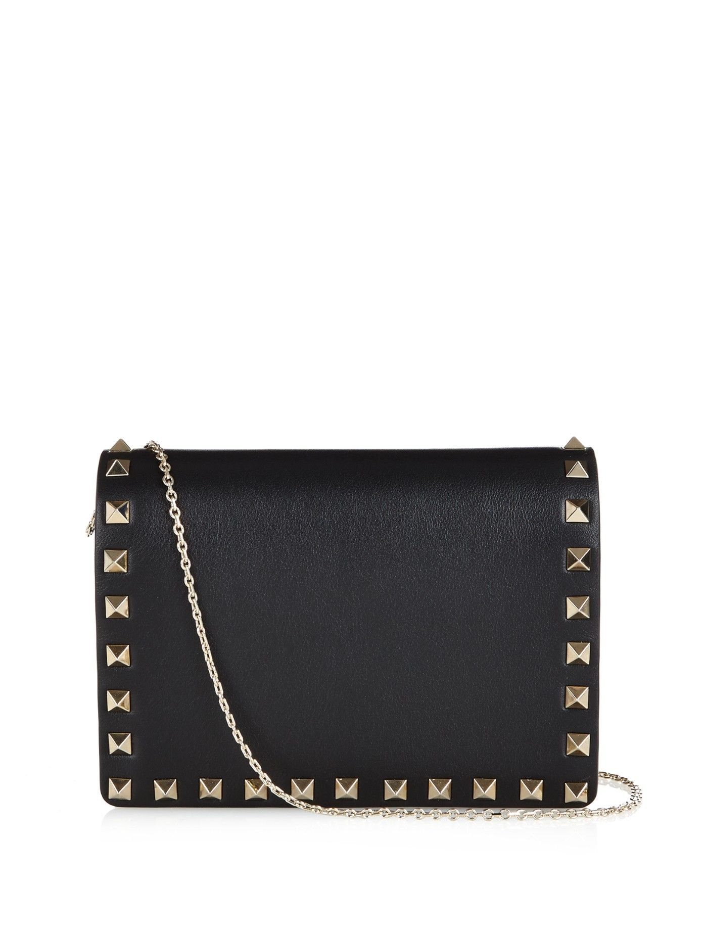 Rockstud leather cross-body bag by Valentino | Shop now at #MATCHESFASHION.COM