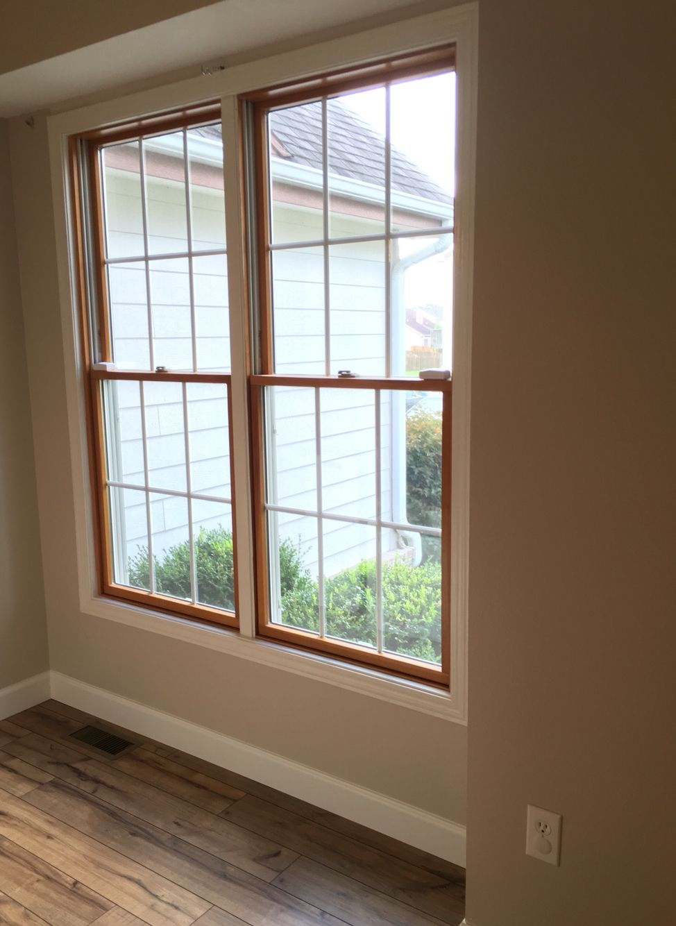 Wood windows white trim shaw laminate floor in for How to paint wood windows interior