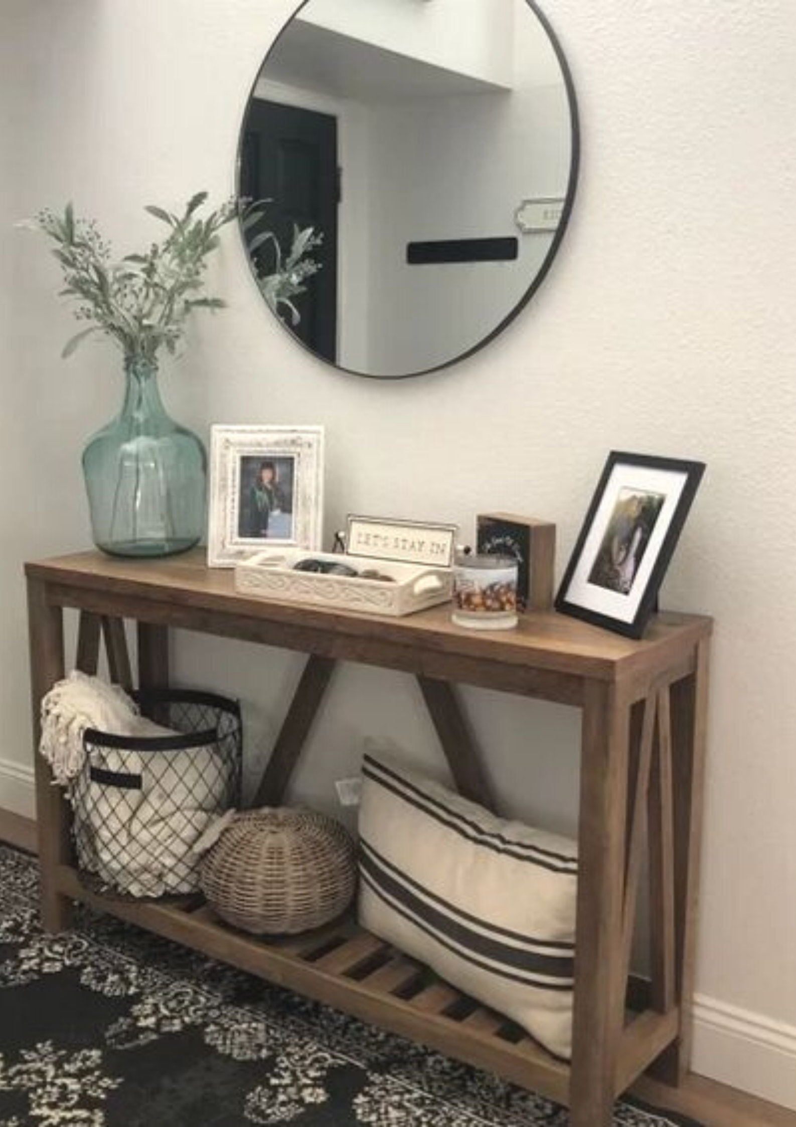 Organized your hallway or entryway with putting together furniture, decor, rugs, and lighting that create a wow factor as soon as you or guests walk in the front door. Check out our most recommended entry table ideas and go style your entryway happily! #entryway #entry #table #entrytableideas #entrywayideas
