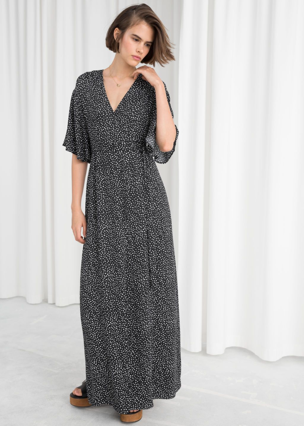 Model Front Image Of Stories In Black Maxi Dress Maxi Wrap Dress Dresses [ 1435 x 1025 Pixel ]