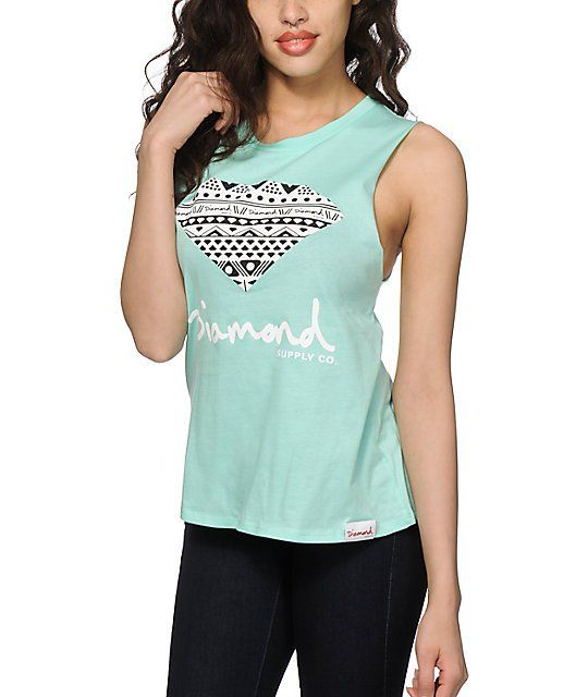 Get your shine on with the comfort and style of this pure cotton muscle tee that features a boyfriend fit with cut-off sleeves and a tribal Diamond graphic at the front.