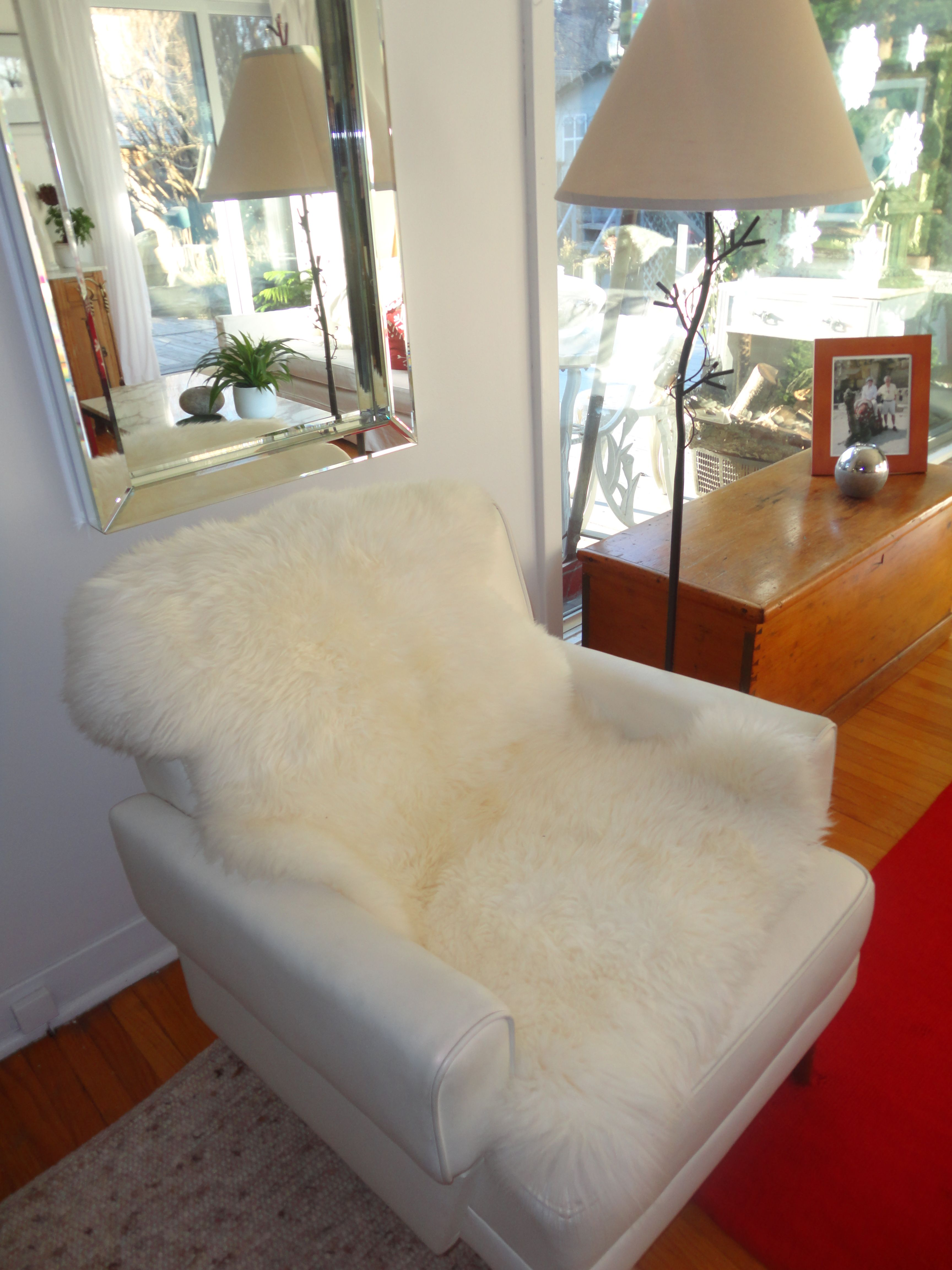 Sheepskin rug makes a leather chair cozy in the winter.