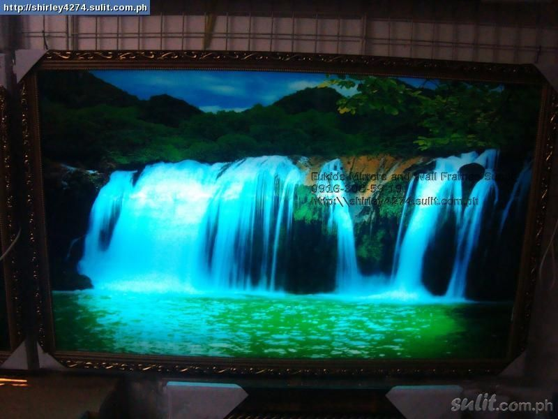 does it get any more gloriously tacky than the moving light up waterfall picture frame