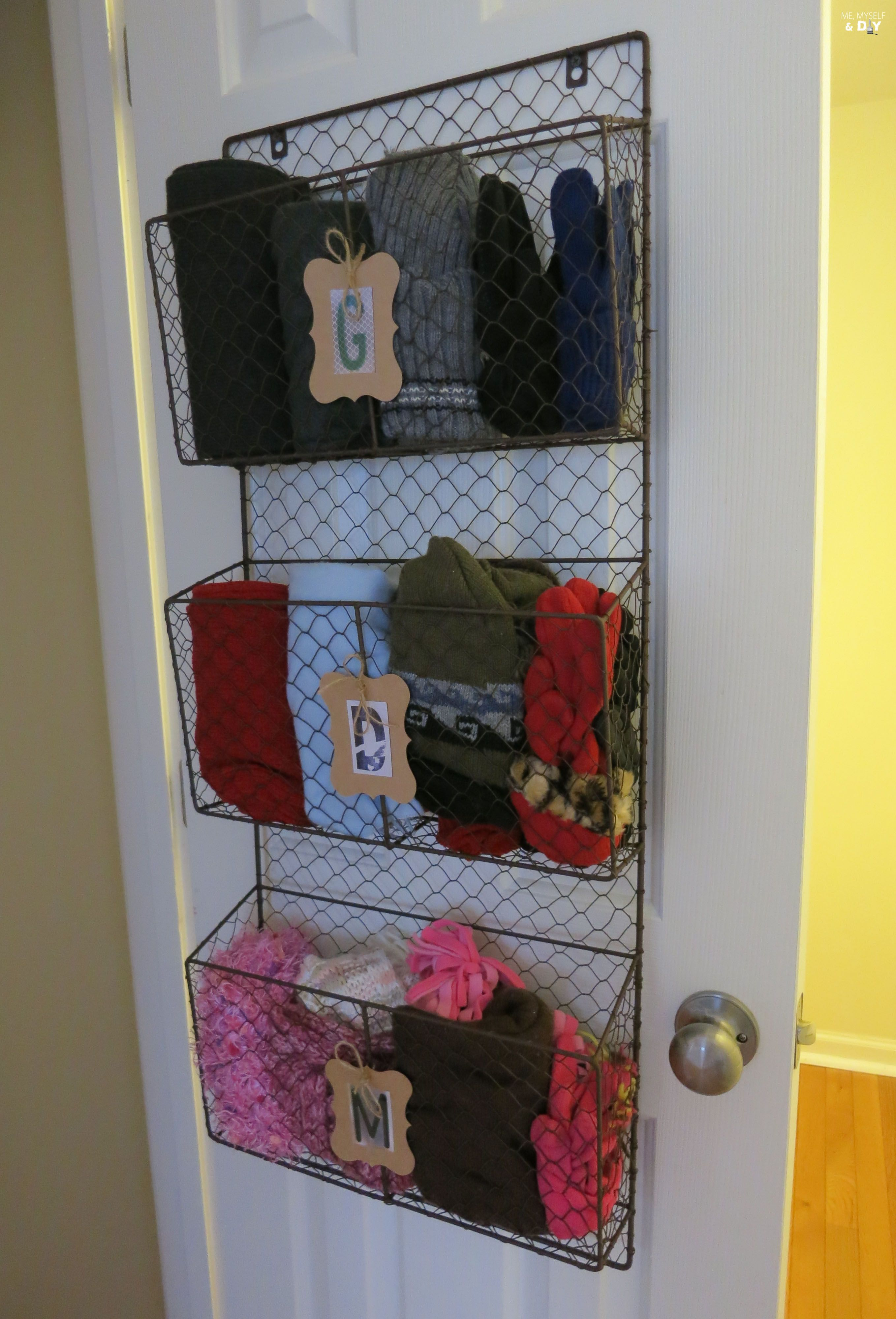 Coat closet makeover using tiered baskets and some
