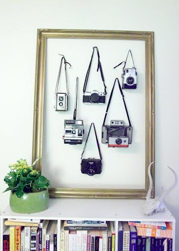 Great way to show off your vintage camera collection.  Hang them on the wall with a vintage frame.