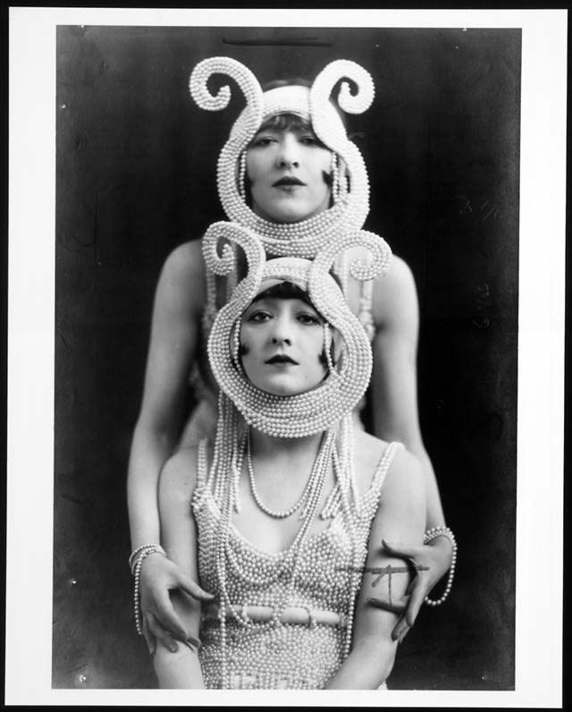 Dolly Sisters--couldn't resist pinning this vintage photo because they look like the inspiration for Princess Beatrice's hat at the royal wedding, right??