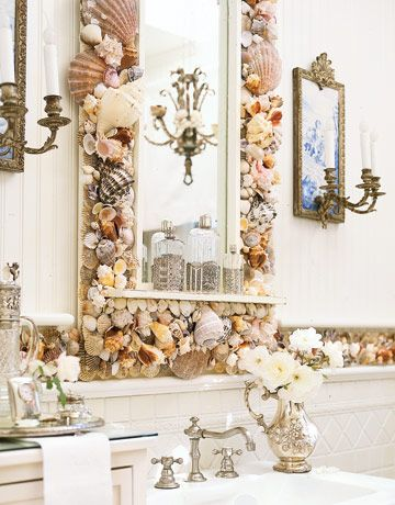 An Extensive Collection Of Seashells Finds A Purpose, Decorating A Bathroom  Mirror.
