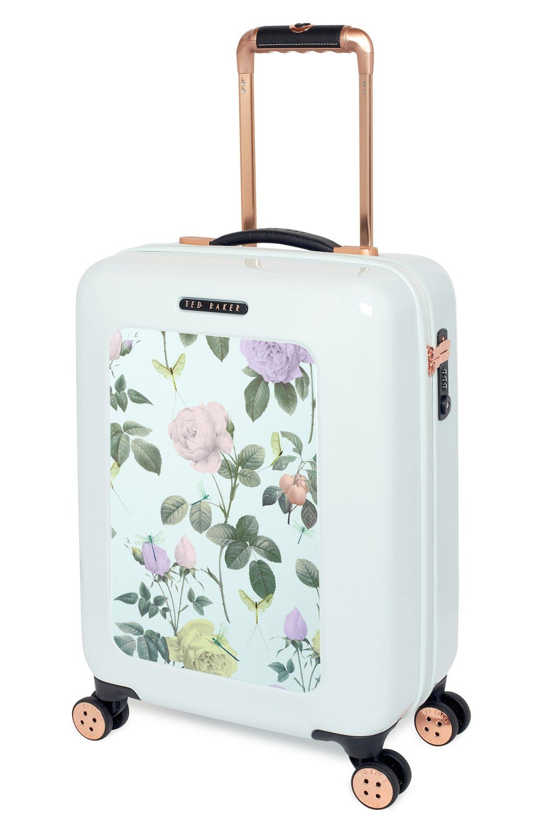 7633383d3468 Traveling in style with this cute mint and rose gold suitcase featuring  pretty pastel blooms.