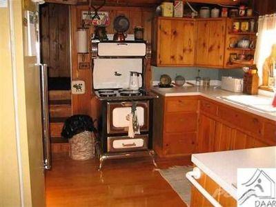Log cabin kitchen tiny kitchens and baths pinterest for Log cabin kitchens and baths