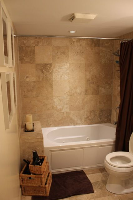 Tile tub wall matches floor color scheme browns tans and for Brown tile bathroom ideas