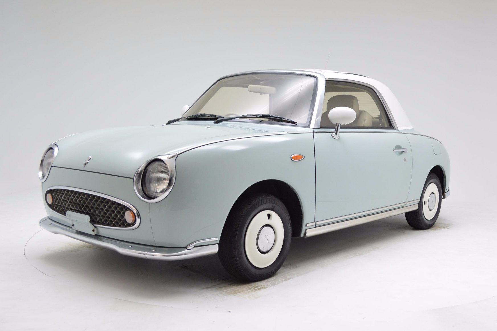 This 1991 Nissan Figaro has 80K kilometers (50K miles) and was ...
