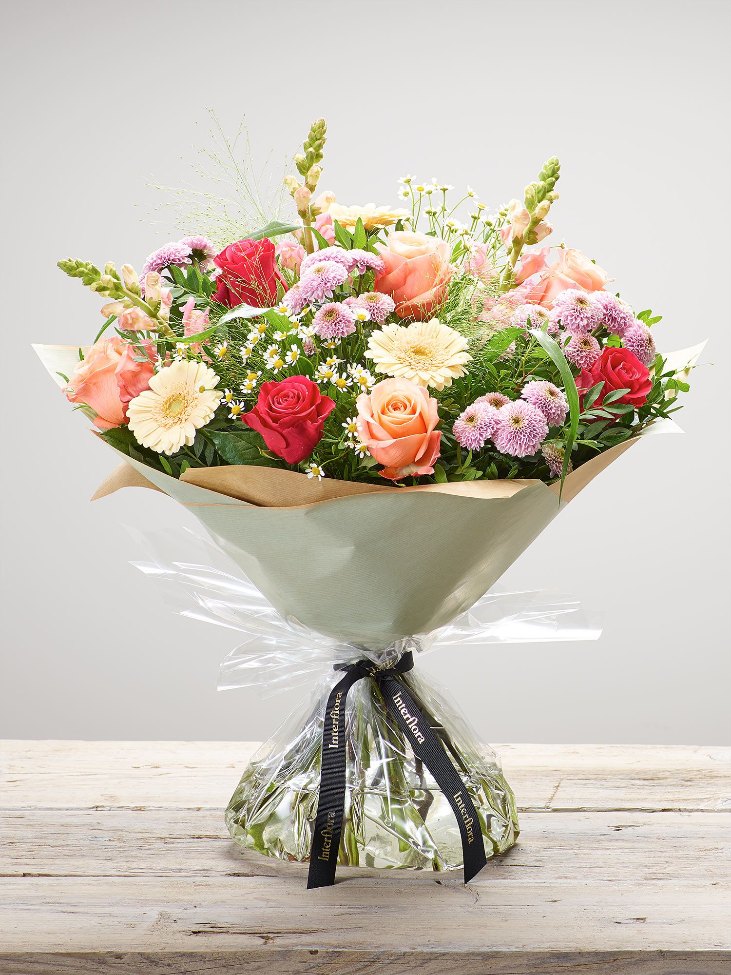 Featuring salmon large headed roses, cerise large headed