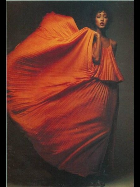 Pat Cleveland in Orange Halston Pleats - Vintage Halston.  In the 70s I had a robe, which I wore until it came to pieces: silk, gorgeous, like a second skin.