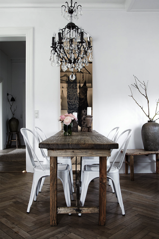 This modern rustic dining room is accented perfectly with a crystal this modern rustic dining room is accented perfectly with a crystal chandelier aloadofball Choice Image
