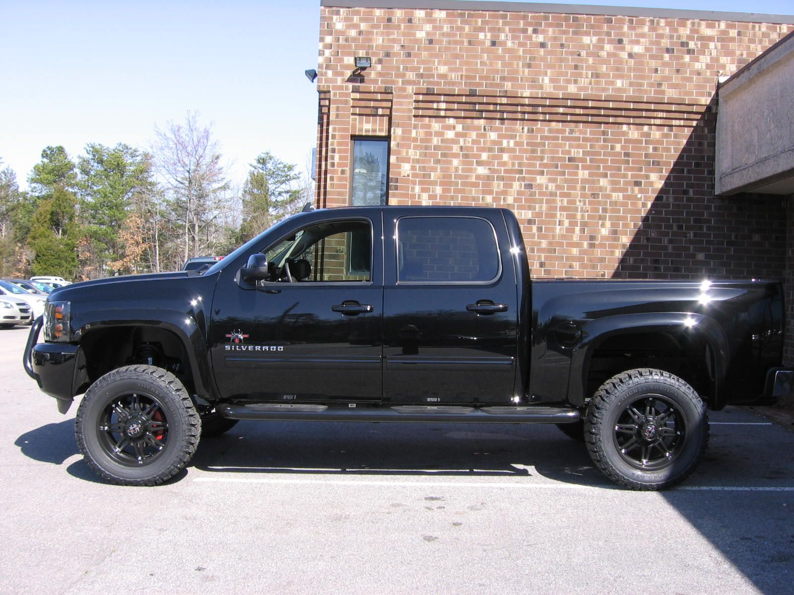 All new black widow addtion 2012 chevrolet silverado custom made by southern comfort has the black widow package with mickey thompson