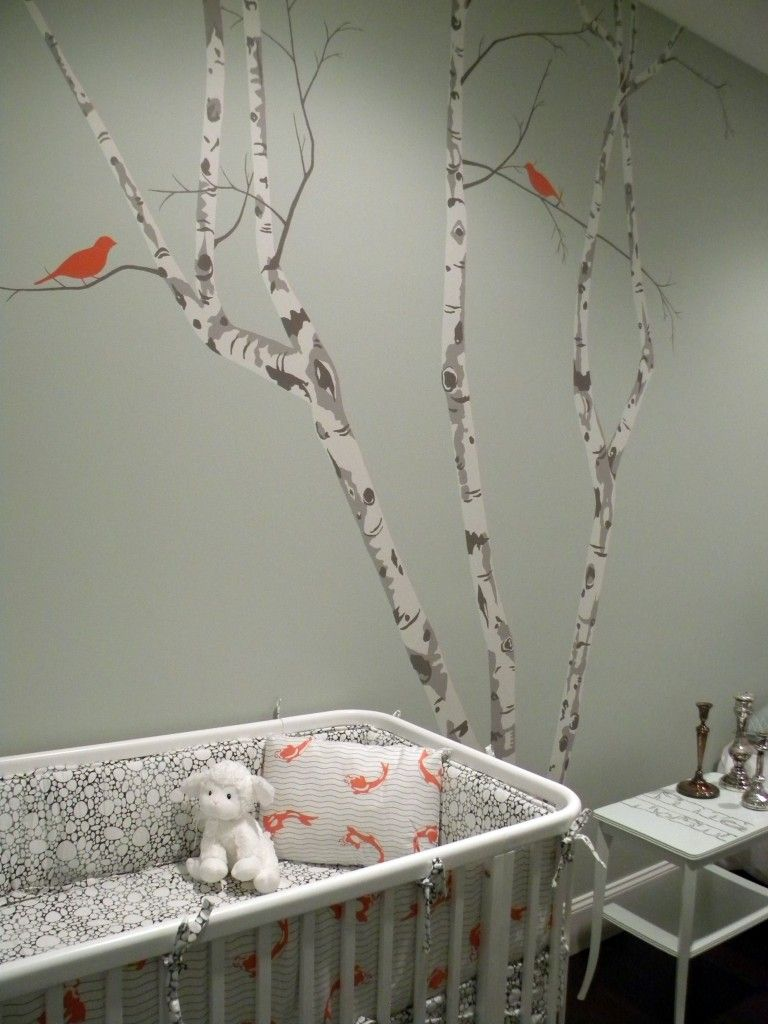 Baby room decorations - Gender Neutral Nursery Design With Gray Green Walls Paint Color Birch Tree Wall Stencil Mural White Modern Crib And Frosted Glass Doors